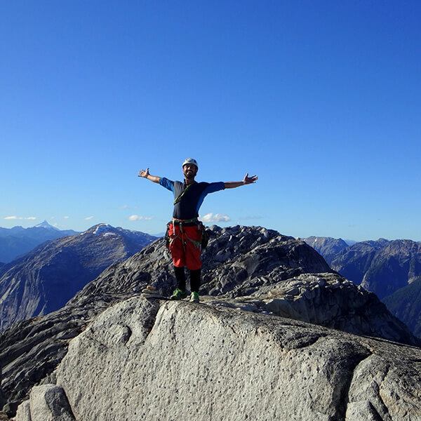 Rock climber at the top of the mountains