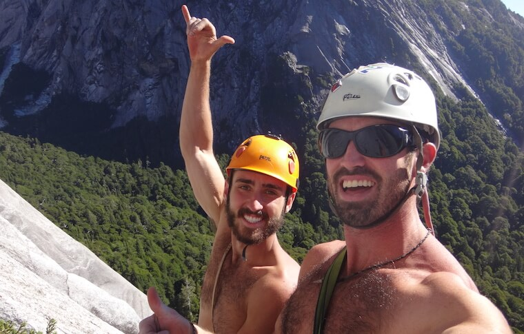 Two guys in helmets on a mountain