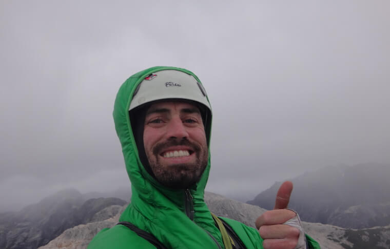 A man with his thumb up in the fog