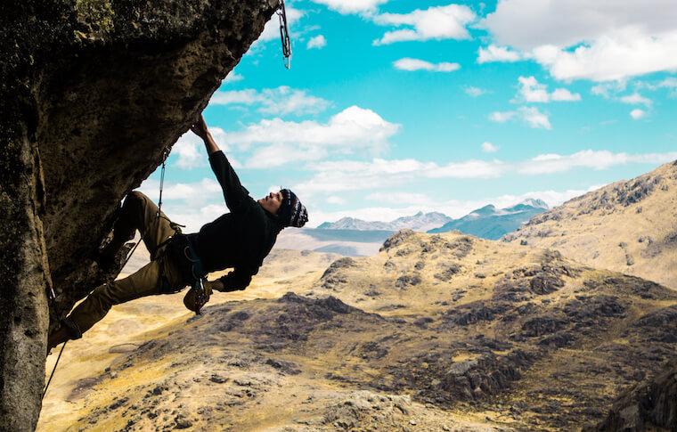 A climber hanging off a cliff