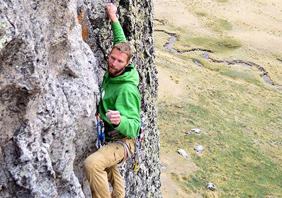 A guy climbing a mountain