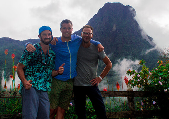 Three guys with a mountain in the background