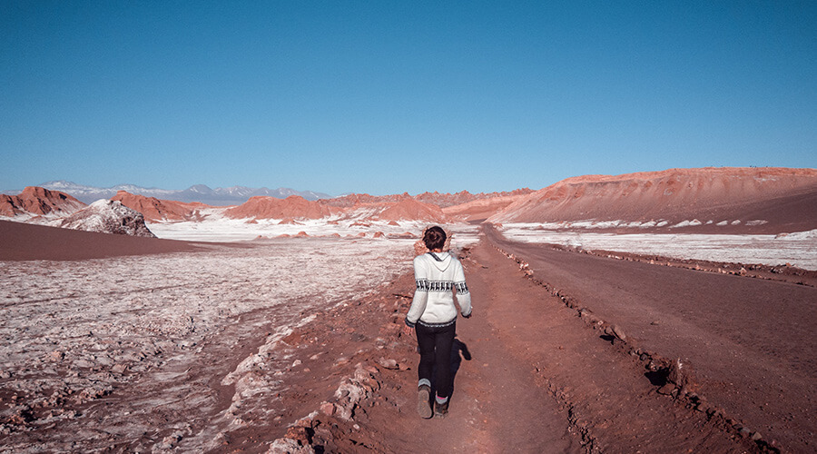 Tourist walking through the desert in Atacama