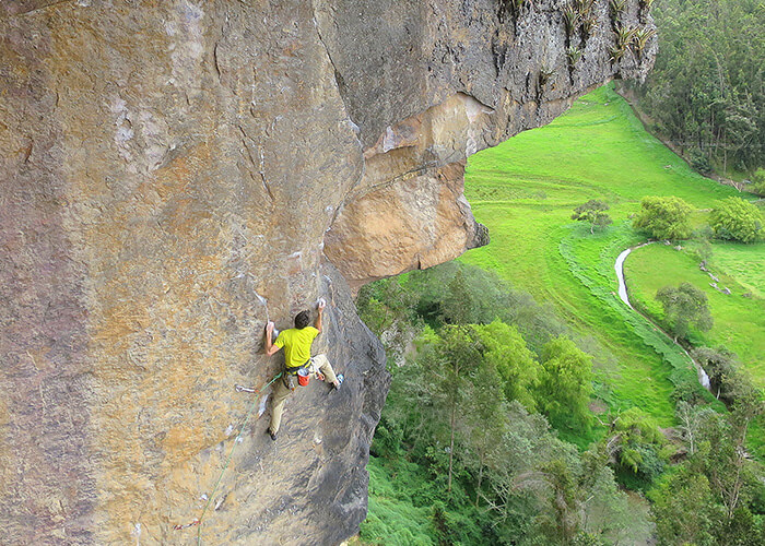 Man rock climbing in the mountains of Colombia