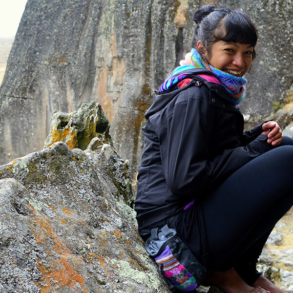 Woman climber resting in the mountains