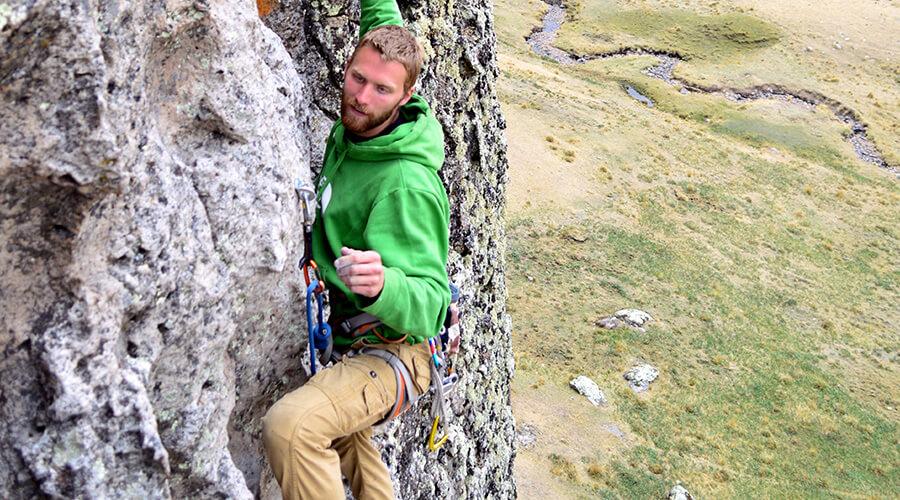 Man climbing a rocky mountain wall