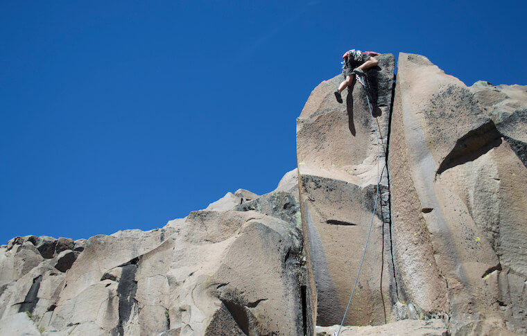 A climber getting onto the mountain top