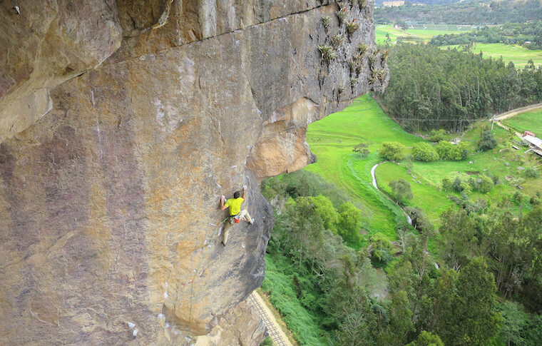 A climber clinging to a rock