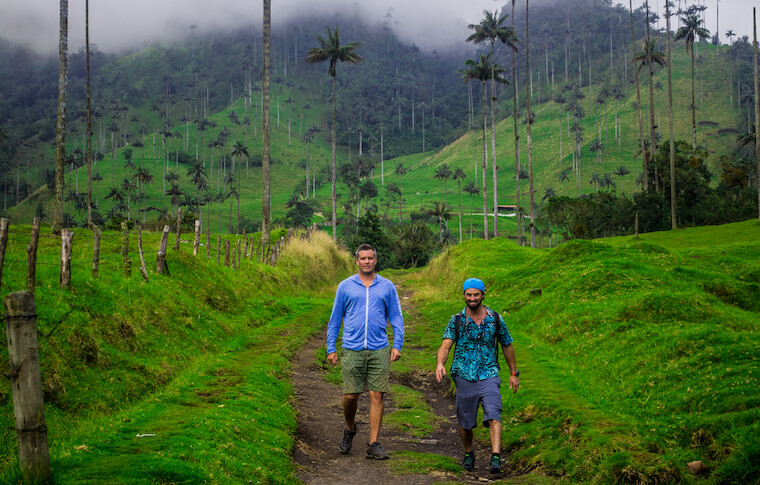 Two tourists walking down the hills in Colombia