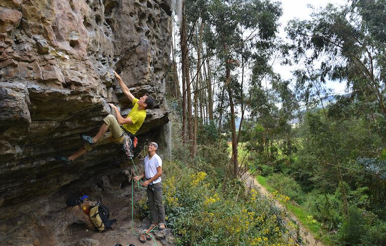 A man rock climbing with an instructor