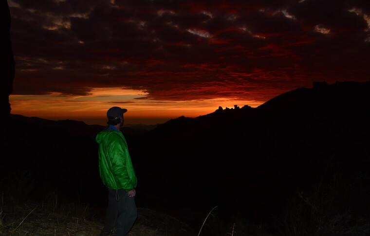 An orange sunset on the mountain top