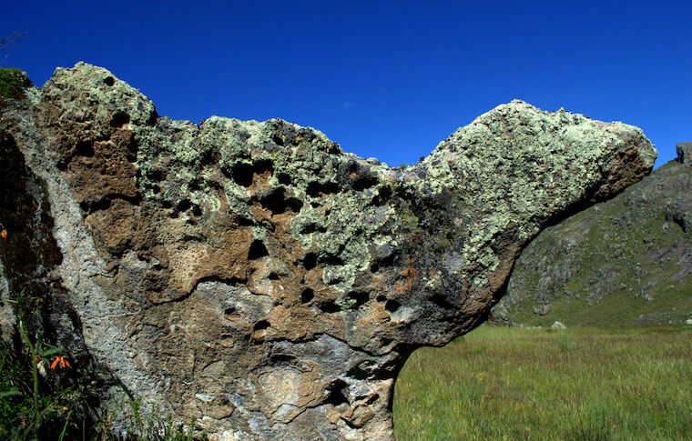 A rock of unusual shape and texture