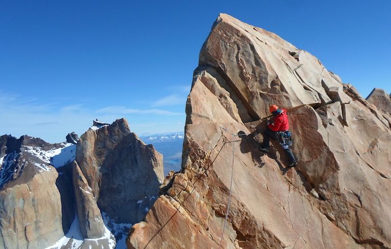 Climber at the top of a mountain
